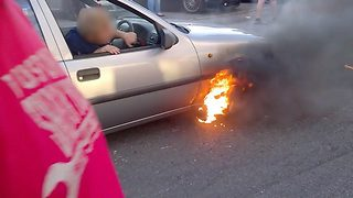 Burning rubber! Mad-cap petrolhead suffers 'ultimate wheel spin fail' – as he sets car ablaze in process - Video