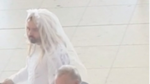 Here Comes the Bride: Man Walks Through Dublin Airport in Wedding Dress