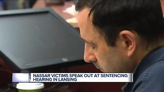 Coach tells Larry Nassar to 'go to hell' as victims speak out at sentencing - Video