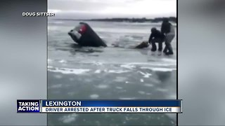 Police arrest driver after truck falls through ice