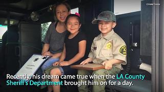 A group of local law enforcement officers made this little boy's dream come true - Video