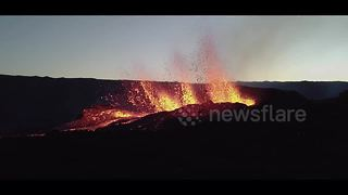 Drone footage shows volcano erupting on Reunion island