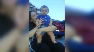 A Baby Boy Frowns While He Watches Fireworks - Video