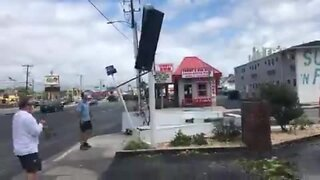 Isaias leaves the sign for Coins Restaurant & Pub in Ocean City destroyed