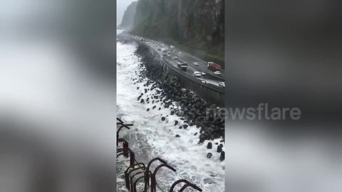 Giant waves invade Reunion Island motorway during tropical cyclone