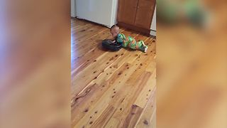 A Baby Boy Rides On A Roomba Vacuum - Video