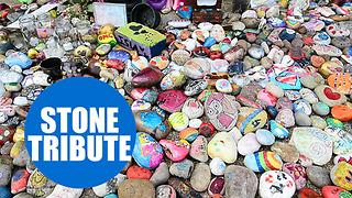 Thousands of painted stones have been laid at a bandstand in memory - Video