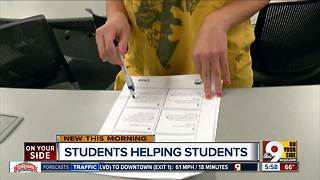 Xavier U students help younger kids get ready