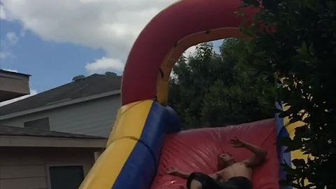 Man Leaps Off Roof Into Bounce Slide And Into A Tree