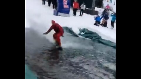 Snowboarder surfing ends up in classic epic fail