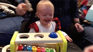Adorable watch – baby girl can't stop giggling at her dad playing with new toy