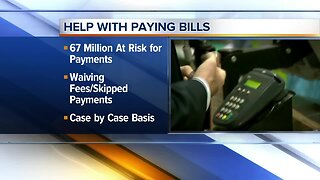 Banks assisting customers with credit card payments