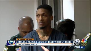 Cousin charged with hiding double murder suspect from police - Video