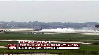 Fllights temporarily delayed at MKE airport after lighting strikes military plane, forcing landing - Video