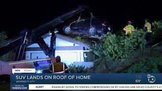 SUV lands on roof of home
