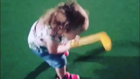 A Tot Girl Tries To Putt But Misses Ball Every Time