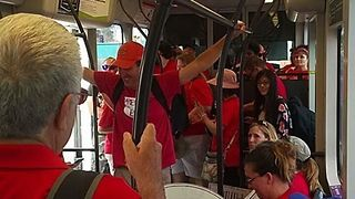Arizona Teachers Crowd Light-Rail Trains for March to Capitol - Video