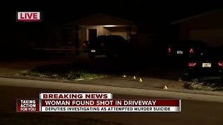 Woman found shot in the driveway