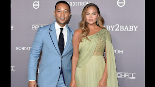 Chrissy Teigen buys John Legend a robe every year