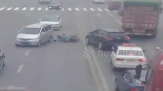 Lucky Escape As Biker Comes Inches From Having His Head Run Over - Video