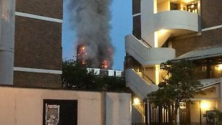 Smoke Rises From West London Apartment Fire - Video