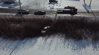 Driver Escapes Injury After Car Veers Onto Frozen Pond - Video