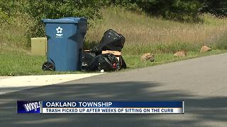 Trash picked up after weeks of sitting on the curb in Oakland Township - Video