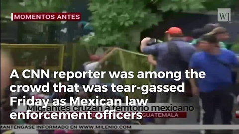 CNN Reporter Hit With Tear Gas While Reporting On Migrant Caravan