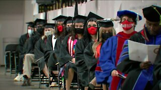 Two local universities celebrate graduates in different ways
