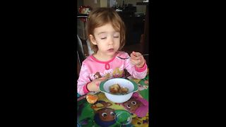 Sleepy toddler tries to eat pancakes