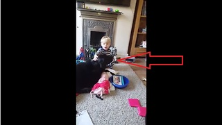 Little boy preciously sings his dog a lullaby - Video