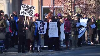 Akron teachers rally over school assaults - Video
