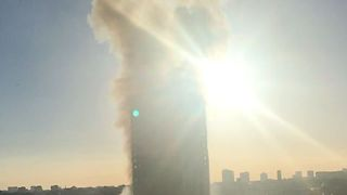 Dawn Breaks as London High-Rise Continues to Burn - Video