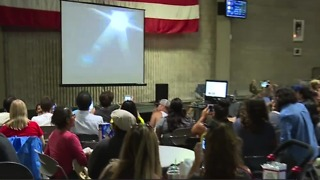 Las Vegas residents wait for a glimpse of solar eclipse at planetarium watch party - Video