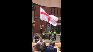 Tommy Robinson protesters chant loudly outside Leeds Crown Court - Video