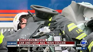 Woman rescued from light rail train crash - Video