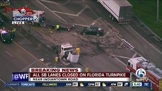 Semi, vehicle crash on Turnpike southbound closes road - Video