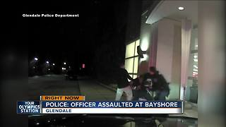 Video shows moment after officer gets punched - Video