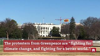 Protesters hang resist sign in DC | Rare News - Video