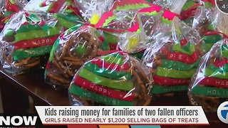 Candy bags raise money for families of fallen officers - Video