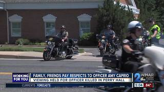 Public viewing draws hundreds for fallen officer - Video