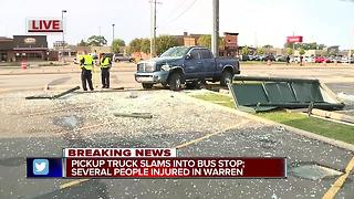Pickup truck slams into bus stop, several people injured - Video