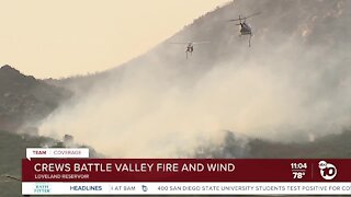 Crews battle Valley Fire and wind