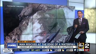 Man rescued at edge of California waterfall - Video