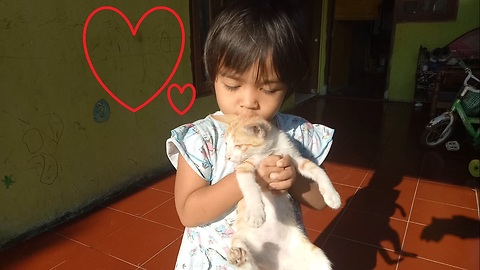 A Kid Shows Love of Her Best Cat Friend
