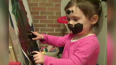 Hilarious Toddler Girl Uses Her Face To Paint A Picture