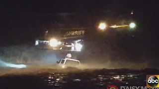 Woman rescued from floodwaters in New River - Video