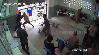 CCTV footage shows prisoner incredible escape past police guards - Video