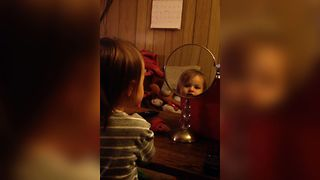 Little Girl Loves Her Reflection - Video