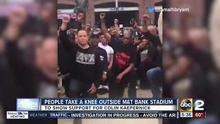 Fans show support for Colin Kaepernick by kneeling outside M&T Bank Stadium - Video